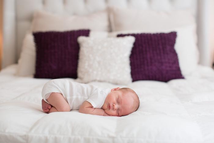lifestyle, newborn, photography, session, photo shoot, houston, texas, kelli nicole photography, baby boy, white onesie, white bed