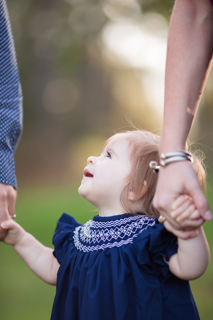 houston, family, photography, photographer, baby, child, children, memorial park, texas, blue dress, toddler, girl, family of three, woods, nature, color, maroon, navy, kelli nicole photography, holding hands