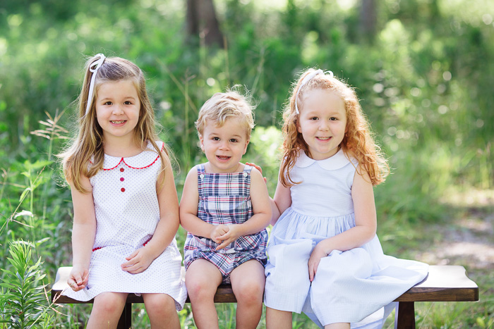 houston family photographer, houston family photography, memorial park houston, family, sisters, color, blue dresses, kelli nicole photography, red head, family of five, bench, three siblings, two sisters and one brother