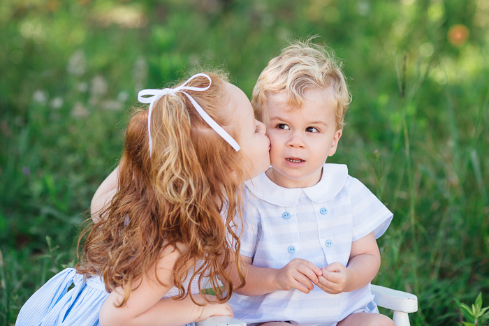 houston family photographer, houston family photography, memorial park houston, family, sisters, color, blue dresses, kelli nicole photography, red head, family of five, sister kissing baby brother,