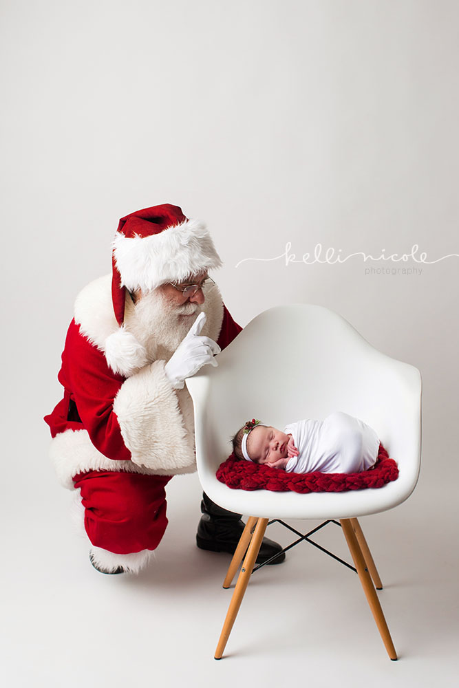 santa, santa claus, newborn, newborn photography, newborn with santa, houston newborn photography, houston newborn photographer, santa baby, santa newborn, newborn santa, eames chair with newborn, studio newborn, paul c buff einstein lighting, kelli nicole photography