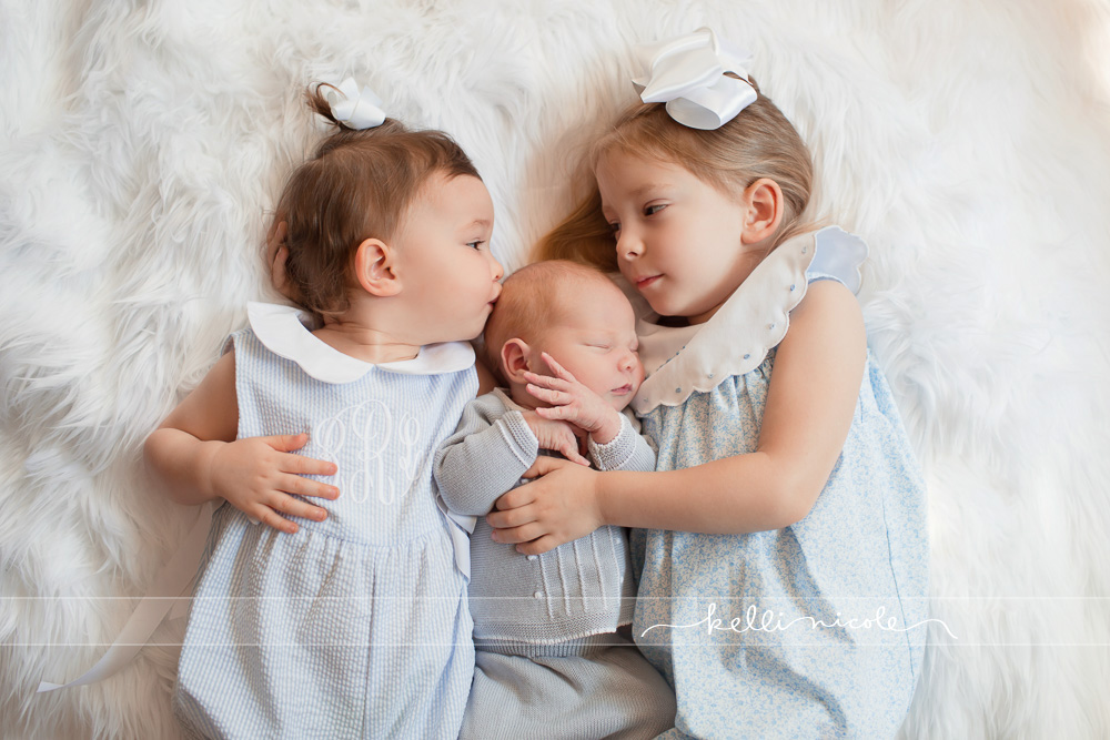 posed, newborn, photography, session, photo shoot, houston, texas, kelli nicole photography, baby boy, color, newborn photography, houston newborn photographer, newborn boy, neutrals, newborn posing, big sisters, baby brother, baby kisses