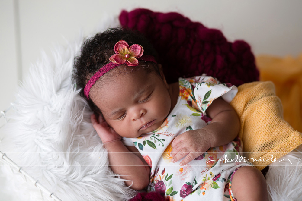 posed, newborn, photography, session, photo shoot, houston, texas, kelli nicole photography, baby girl, color, newborn photography, houston newborn photographer, studio, newborn girl, newborn posing, colorful newborn, white flooring, ruby, yellow,