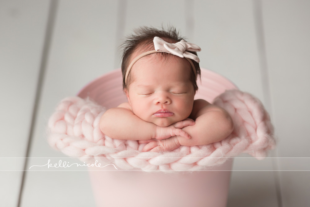 posed, newborn, photography, session, photo shoot, houston, texas, kelli nicole photography, baby girl, color, newborn photography, houston newborn photographer, studio, newborn boy, newborn posing, newborn photography tutorial, studio newborn lighting, paul c buff einstein lighting, baby girl, white wood backdrop, pink bucket, white and pink newborn