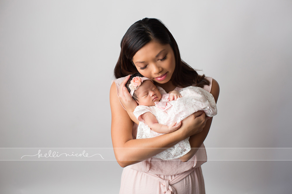 posed, newborn, photography, session, photo shoot, houston, texas, kelli nicole photography, baby girl, color, newborn photography, houston newborn photographer, studio, newborn girl, newborn posing, newborn photography tutorial, studio newborn lighting, paul c buff einstein lighting, baby girl, houston newborn photography, white backdrop, white and pink newborn, dad and newborn, asian newborn, asian baby, mom, mom and newborn, mom and baby