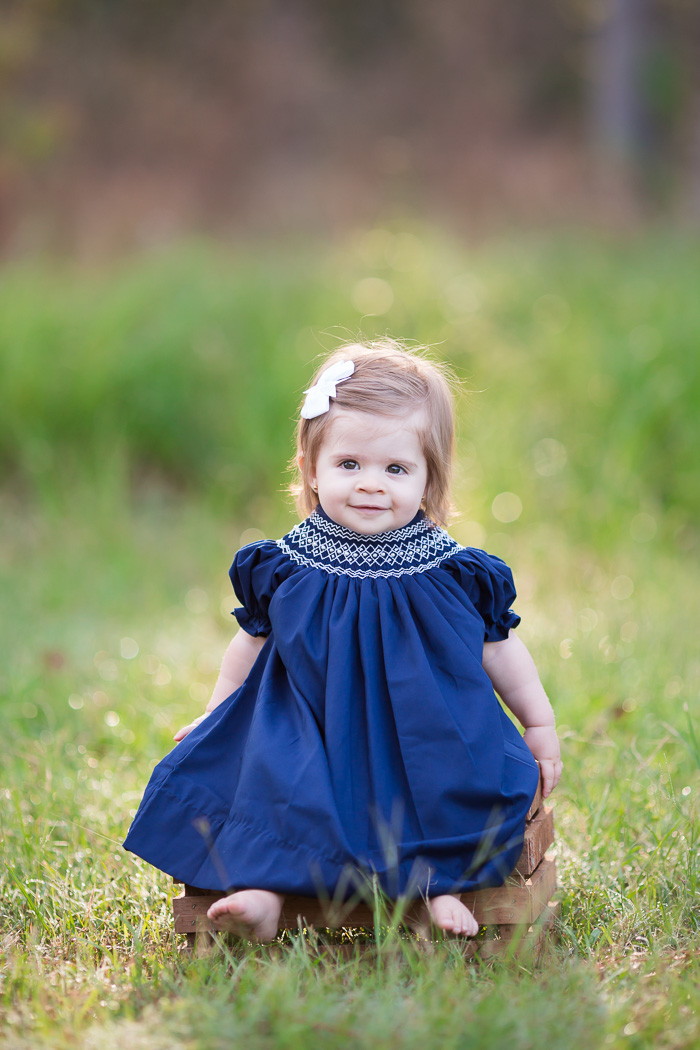 houston, family, photography, photographer, baby, child, children, memorial park, texas, blue dress, toddler, girl, family of three, woods, nature, color, maroon, navy, kelli nicole photography, backlit