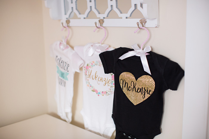 lifestyle, newborn, photography, session, photo shoot, houston, texas, kelli nicole photography, baby girl, nursery, color, mckenzie, onesie, heart, gold, black