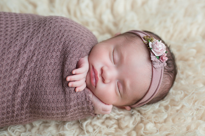 posed, newborn, photography, session, photo shoot, houston, texas, kelli nicole photography, baby girl, color, selena, fur, newborn photography, houston newborn photographer, purple newborn, studio, purple wrap, headband, flokati