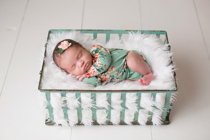 posed, newborn, photography, session, photo shoot, houston, texas, kelli nicole photography, baby girl, color, selena, fur, newborn photography, houston newborn photographer, purple newborn, studio, hardwood floors, floral newborn romper, white fur, turquoise, mint, teal, white floors
