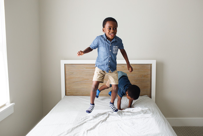 houston lifestyle photography, family photography, family photo shoot at home, black family, nigerian family, african family, children, child, brothers, kelli nicole photography, kelli nicole, jumping on the bed