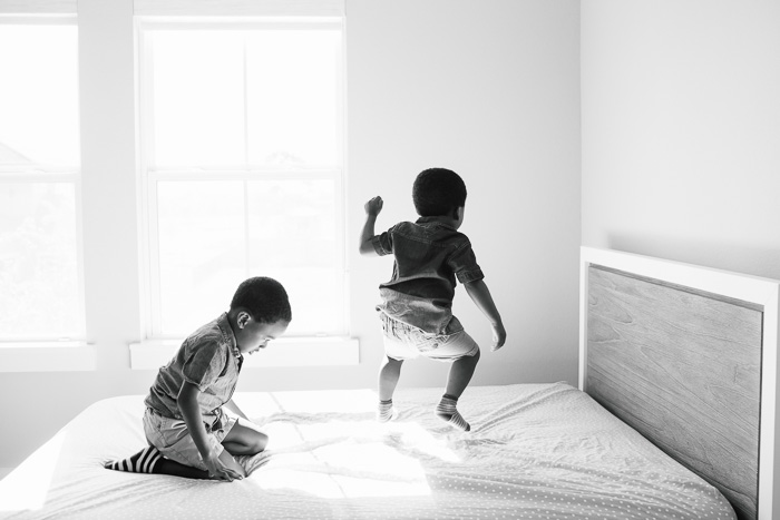 houston lifestyle photography, family photography, family photo shoot at home, black family, nigerian family, african family, children, child, brothers, kelli nicole photography, kelli nicole, black and white, jumping on the bed