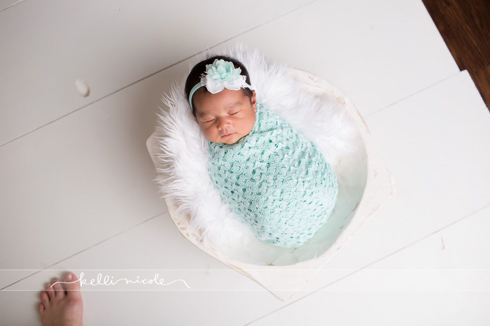 posed, newborn, photography, session, photo shoot, houston, texas, kelli nicole photography, baby girl, color, newborn photography, houston newborn photographer, studio, newborn boy, newborn posing, newborn photography tutorial, studio newborn lighting, paul c buff einstein lighting, white fur, white background, white bowl, white flooring, aqua wrap, mint