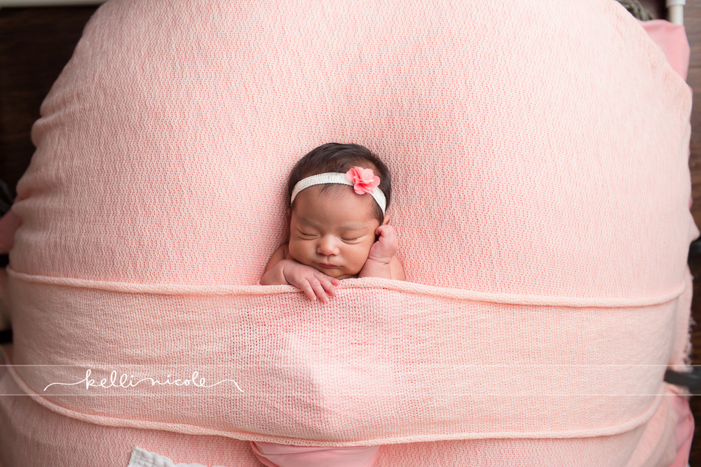 posed, newborn, photography, session, photo shoot, houston, texas, kelli nicole photography, baby girl, color, newborn photography, houston newborn photographer, studio, newborn boy, newborn posing, newborn photography tutorial, studio newborn lighting, paul c buff einstein lighting, pink, tucked in pose, newborn girl