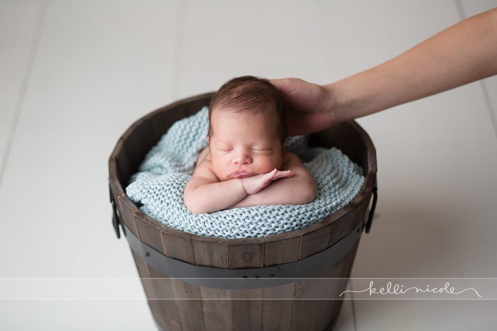 posed, newborn, photography, session, photo shoot, houston, texas, kelli nicole photography, baby girl, color, newborn photography, houston newborn photographer, studio, newborn boy, newborn posing, newborn photography tutorial, studio newborn lighting, paul c buff einstein lighting, newborn boy, floor prop, white boards, bucket, baby in a bucket