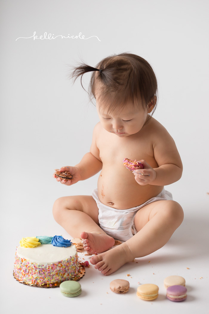 posed, baby, photography, session, photo shoot, houston, texas, kelli nicole photography, baby, color, baby photography, houston baby photographer, studio, baby girl, baby posing, photography tutorial, studio baby lighting, paul c buff einstein lighting, 1 year old, cake smash, macaron smash
