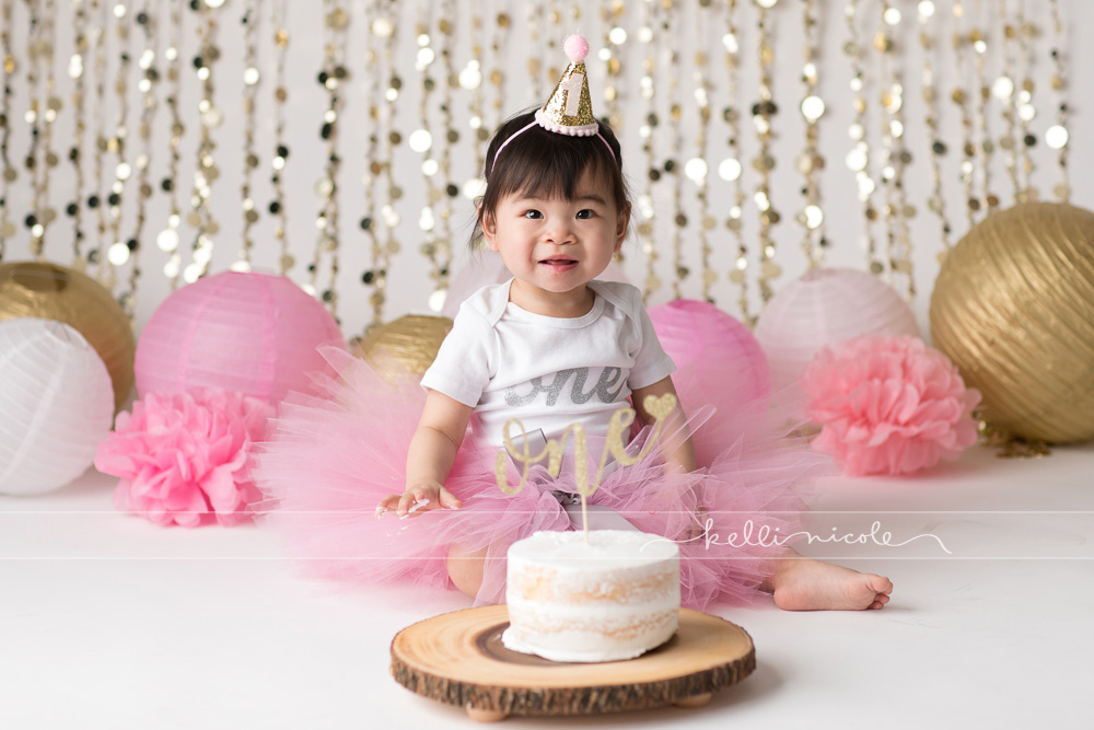 posed, children, photography, session, photo shoot, houston, texas, kelli nicole photography, baby girl, color, baby photography, houston baby photographer, studio, baby girl, child posing, baby photography tutorial, studio baby lighting, paul c buff einstein lighting, houston family photography, white backdrop, cake smash photography session, white studio, white studio houston, children, cake smash, pink and gold