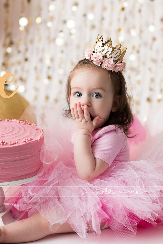 posed, children, photography, session, photo shoot, houston, texas, kelli nicole photography, baby girl, color, baby photography, houston baby photographer, studio, baby girl, child posing, baby photography tutorial, studio baby lighting, paul c buff einstein lighting, houston family photography, white backdrop, cake smash photography session, white studio, white studio houston, children, cake smash, pink and gold and white, one year old